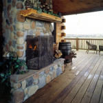 High Peaks Log Homes, log home exteriors, outdoor fireplace on deck